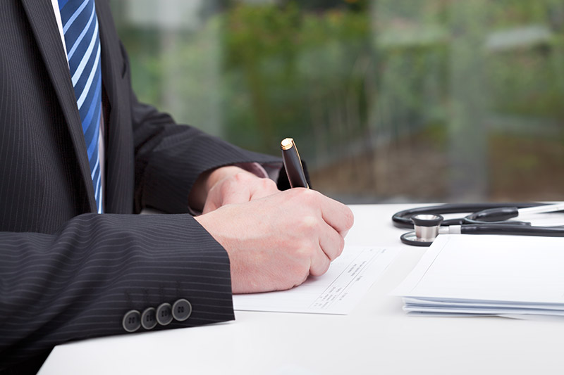 Expert Witness - man writing on paper